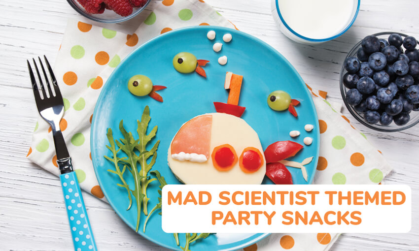 A collection of mad scientist themed party snacks and food.