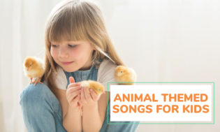 A young girl holding a baby chick and two other baby chicks climbing on her with text that reads animal themed songs for kids.
