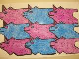 A picture of a tessellation art project, this one has several pigs in the art.