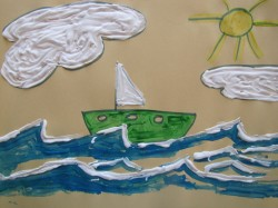 A picture of a boat art project created with shaving cream. The boat is riding on the shaving cream waves and the sun is out.