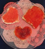A picture of 3 pieces of toast decorated in red toppings.