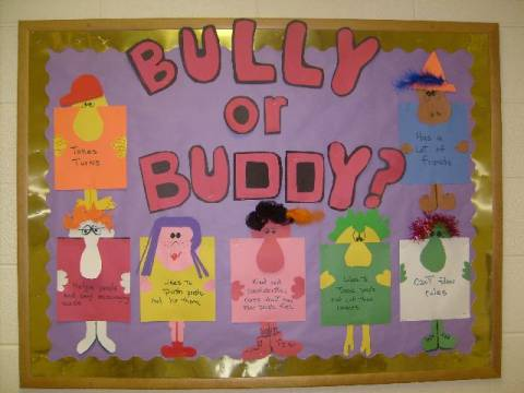 "A bulletin board with six different characters on it made from construction paper. Each character has words or phrases on it. The heading is ""bully or buddy?"""