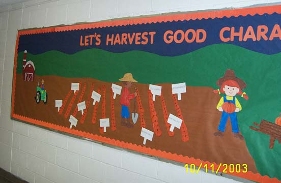 "A bulletin board with a farmer and a field of crops. The heading of the bulletin board reads ""Let's Harvest Good Character."""