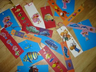 A picture of several bookmarks made from card stock with different stickers on them.