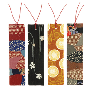 A picture of 4 bookmarks made from various fabric patterns.