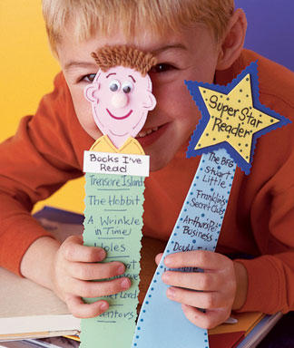 "A picture of two diy foam bookmarks. One has a face with eyes, ears, nose, and mouth that says ""books i've read."" The other bookmark has a star at the top that says Super Star Reader"" and has a list of books that have been read underneath it."