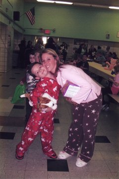 A picture of a mom and daughter in pajamas at a pajama school event.