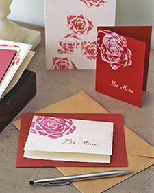 A picture of valentines cards with cabbage ink designs on the cards. When you dip the cabbage in ink and press it on the card, it looks like a beautiful flower.