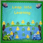 A frog themed bulletin board. A picture of frogs in a lake and lily pads with a heading that says Lean into Learning.