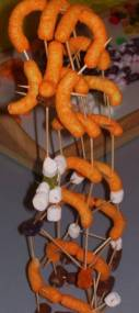 An image of cheese puffs and marshmallows connected by toothpicks demonstrating the science project mentioned.