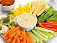 A vegetable tray with dip.