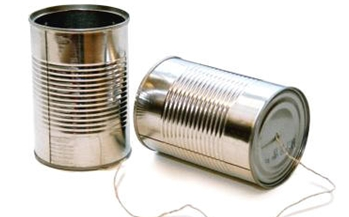 An image of two silver tin cans with a string attached to the bottoms turning them into a telephone.