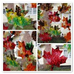 A picture of leaf stained glass. Four different images. Red, green, and orange leaf designs on windows.