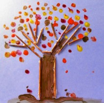 A picture of a toothpick tree. The toothpicks are used to make tree branches and the trunk of the tree. There is red, yellow, and brown paint to represent the leaves.
