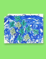 "This leaf themed art project is ""leafs blowing in the wind."" The leaves are dark and light green with leaf veins."