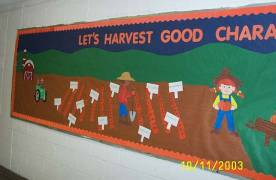 An art/craft project showing animated pictures of people workin in a garden. Text over the garden that says lets harvest good.