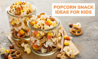 A picture of two glasses of popcorn trailmix snack. Text reading popcorn snack ideas for kids.