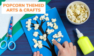 A picture of an art project, a tree with popcorn being the leafs. A childs hand putting it together with glue and scissors to the side of the art project. Text reading popcorn themed arts and crafts.
