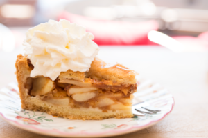 piece of apple pie with whipped cream