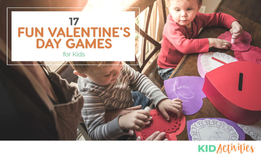 A picture of two young kids putting together valentines crafts. Text reads 17 fun valentines day games for kids.
