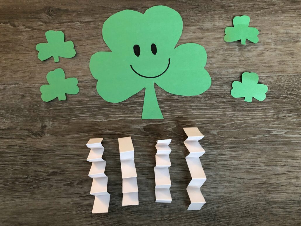 The paper crinkled limbs and smiley face not the shamrock cutouts.