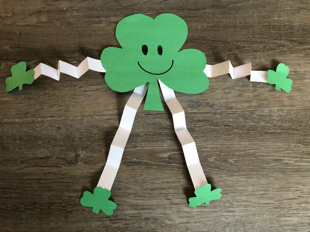 The finished shamrock people craft. A fun St Patrick's Day craft.
