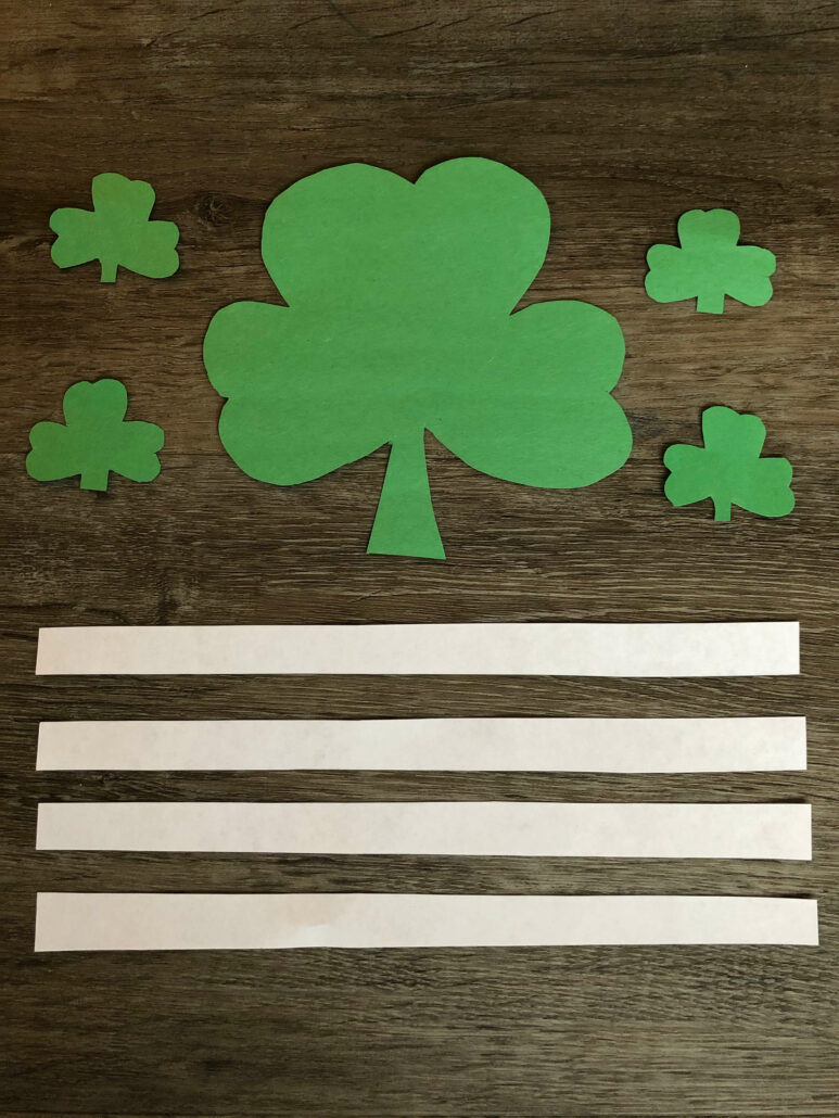 "The cutout pieces for making ""shamrock people"" craft."